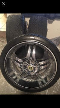 22' chrome rims with three farily new tires