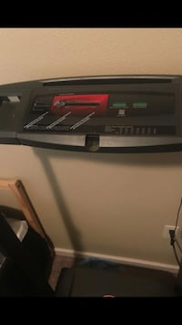 black and gray digital treadmill 2353 mi