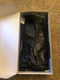Black leather knee-high boots with box