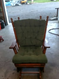 brown wooden framed green padded glider chair Adamstown, 21710
