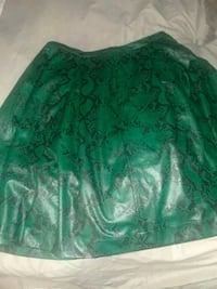 green and white floral textile 56 km