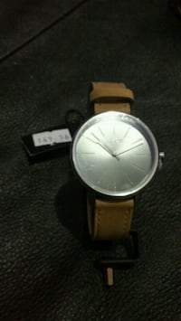 round silver analog watch with brown leather strap Winnipeg, R3E 0M5