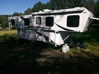 white and gray camper trailer 57 km