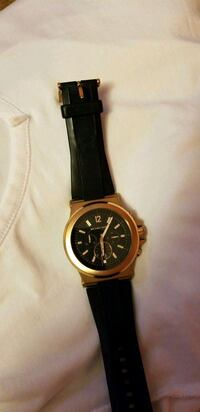 round gold chronograph watch with black leather st Brossard, J4W 2A1