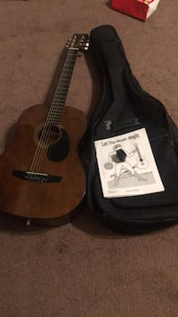 brown dreadnought acoustic guitar with gig bag Hollister, 95023