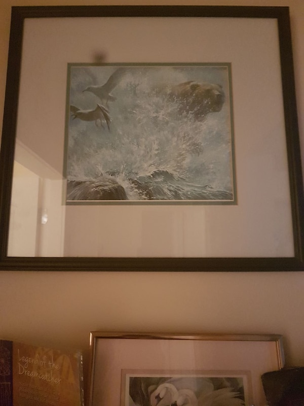 black framed painting of bear jumping on water