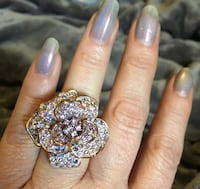 Gold-colored floral ring with gemstones 8