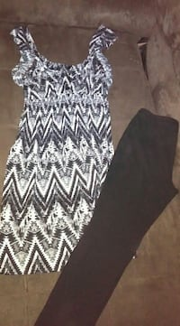 black pants and gray-and-black floral spaghetti st