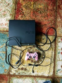 black Sony PS3 slim console with controller and game cases 27 mi