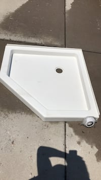 Stand up corner shower base with drain. 37 3/4 by 37 1/2. Never used sat in storage  Cheyenne, 82007