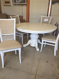 Round white wooden table with four chairs Saugatuck, 49453