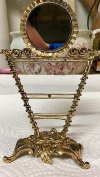 Mid century old vanity mirror ( brass). 6 1/2 inches tall 4 1/2 w Langley, V1M 2J1