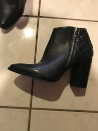 women's pair of back leather heeled booties