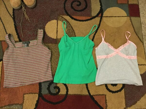 several assorted-color sleeveless shirts