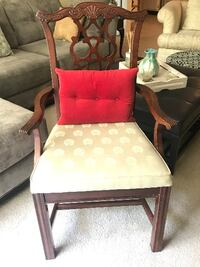 brown wooden framed pink padded armchair null