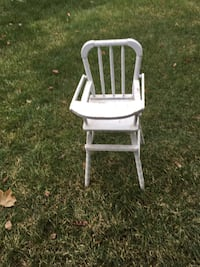 White and brown wooden rocking chair