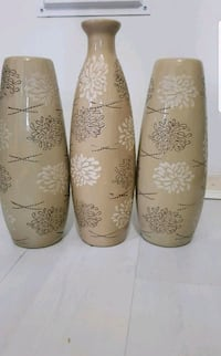 two brown and white floral ceramic vases Leicester, LE3 9PG