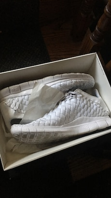 pair of white wicker mid-top sneakers in box