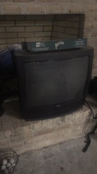 black CRT TV with remote 90 km