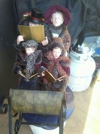 women and men in red and brown fur coat porcelain dolls