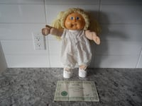 1985 Cabbage Patch Doll. Lisa Dorene. She does come with her Birth Certificate. She does have some surface wear/marks. She is missing her socks. Displays Great! $30 PU Morinville Morinville
