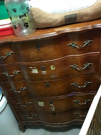Solid wood it's older. You can refinish and it would be a beautiful piece. Make an offer  Linden, 07036