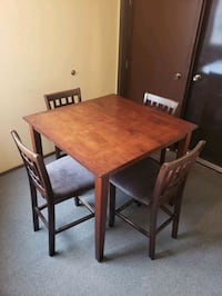 Bar height table +4 chairs