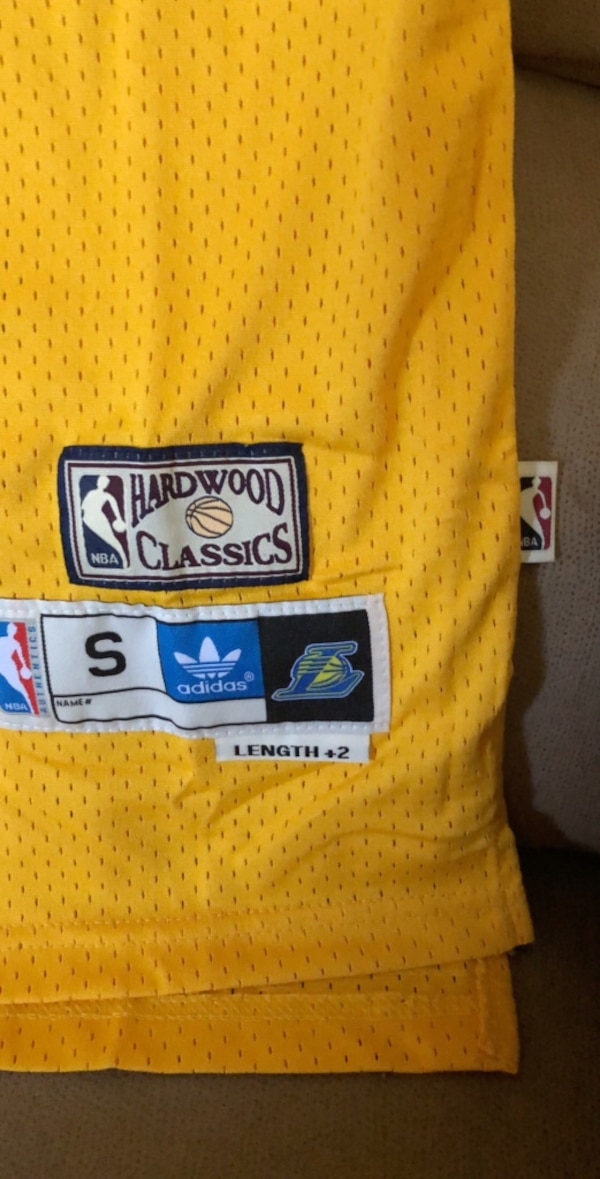 84346866e Used yellow and white Lakers 24 jersey shirt for sale in Chicago - letgo