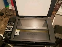 black and gray Canon desktop printer 611 mi