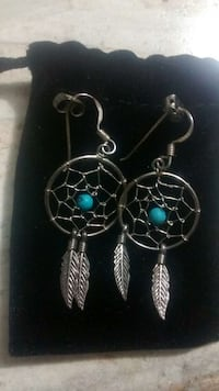 pair of silver-colored dreamcatcher earrings