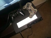 black Sony PS3 slim console with two controllers 2395 mi