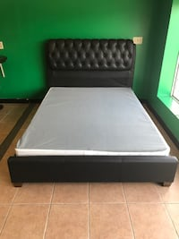 new upholstery queen bed in black color, we delivery, we finance - visit us today! 369 mi