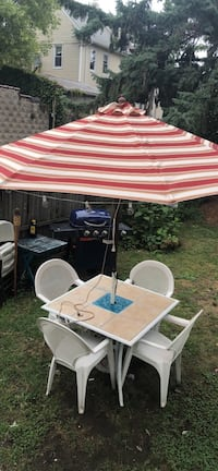 Table umbrella and 4 chairs and grill Paterson, 07513