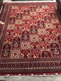 Red and white floral area rug 29 km