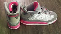 pair of gray-and-pink Nike running shoes Vancouver, V6A 0B6