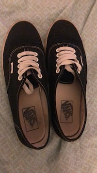 pair of black Vans low-top sneakers 430 mi