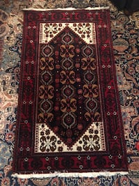 Red, brown, and black floral area rug Toronto, M2R 3N1