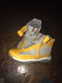 pair of gray-and-yellow Nike basketball shoes 218 km