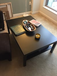 rectangular black wooden coffee table (slightly damaged)