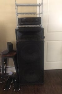 2 stadium concert speakers with stereo systems and stereo stands