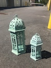 two teal candle lanterns
