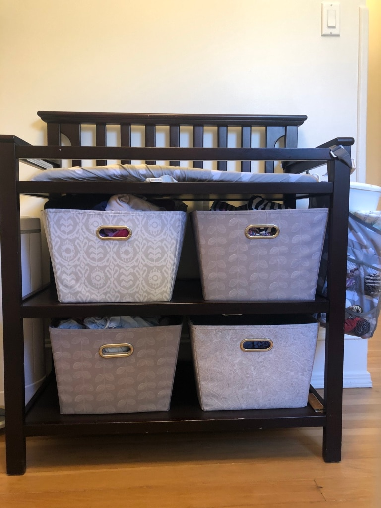 Photo Graco dark wood changing table with pad (bins not included)