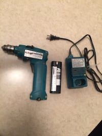 Blue and black makita corded hand drill 787 km
