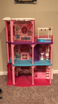 blue, pink, and purple doll house toy 56 km