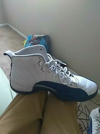 unpaired white and blue Air Jordan 12 shoe St. Louis, 63136
