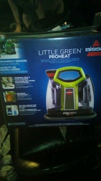 black and yellow Bissell vacuum cleaner box Angus
