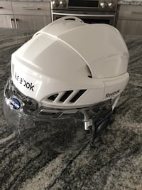 Adult M-L size almost  new Reebok helmet with clear Bauer visor. New this cost $120 together . Comfort cushion padding. Asking $40 OBO Airdrie, T4B 3V5