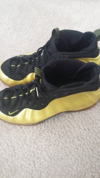 pair of black-and-yellow Nike Foamposite GERMANTOWN