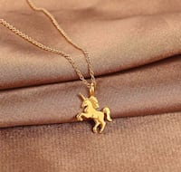 Gold Unicorn Necklace - Brand New in unopened packaging!  Regina, S4X 3B6