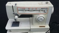 white and gray Singer electric sewing machine Toronto, M5J 2W4
